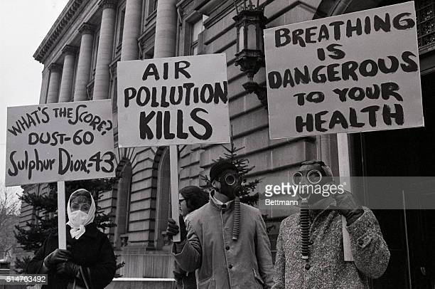 Protesting Cleveland's dirty air these people donned gas and face mask in front of City Hall as a citizens revolt against dirty air was underway in...