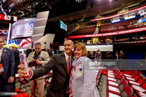 Cleveland Ohio USA July 18 2016 Corey Lewandowski Donald Trump's former campaign manager takes a selfie with a delegate on the floor of the...