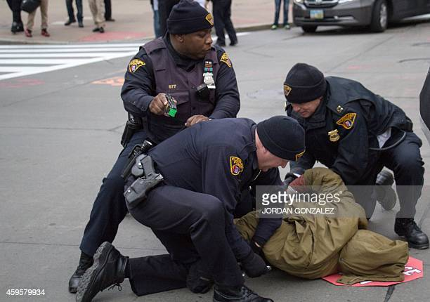 Cleveland police arrest a protester in Cleveland Ohio during a demonstration in which they blocked the roads leading to Public Square November 25...
