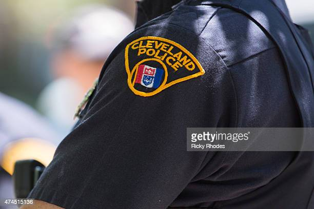 Cleveland police officer looks on as people take to the streets and protest in reaction to Cleveland police officer Michael Brelo being acquitted of...