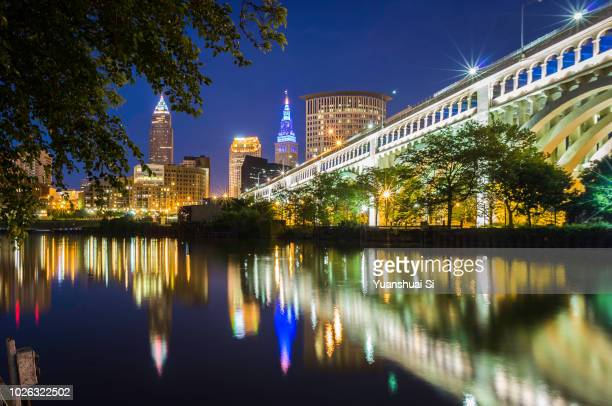 cleveland skyline at night - cleveland ohio stock photos and pictures
