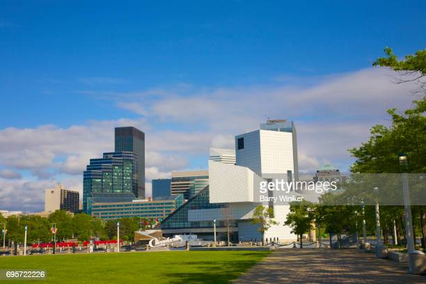 cleveland skyline from voinovich park - rock and roll hall of fame cleveland stock photos and pictures
