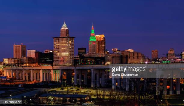 cleveland skyline view from the south west on the christmas night - cleveland, oh, usa. december 2019 - rock and roll hall of fame cleveland stock pictures, royalty-free photos & images