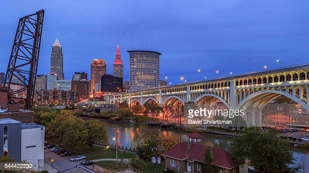 cleveland skyline view with veterans memorial bridge in the evening lights. - rock and roll hall of fame cleveland stock pictures, royalty-free photos & images