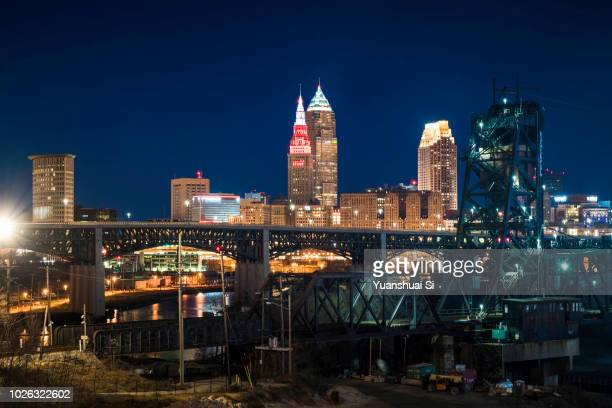 cleveland skyline with a bridge - rock and roll hall of fame cleveland stock pictures, royalty-free photos & images
