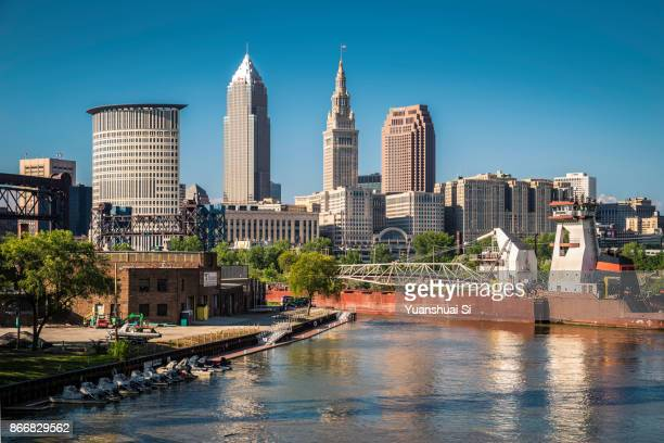 cleveland skyline with an vessel - cleveland ohio stock photos and pictures