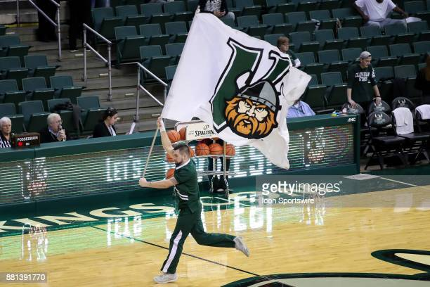 Cleveland State Vikings cheerleader runs the Viking flag on the court prior to the third quarter of the women's college basketball game between the...