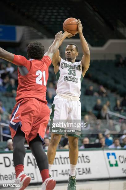 Cleveland State Vikings F Demonte Flannigan shoots over Detroit Titans F Jaleel Hogan during the first half of the men's college basketball game...