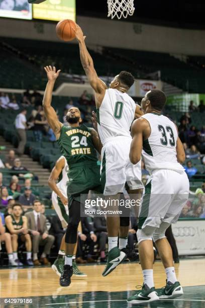 Cleveland State Vikings F Derek Sloan defends the shot of Wright State Raiders G Mark Alstork during the second half of the men's college basketball...