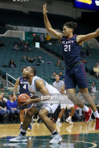 Cleveland State Vikings forward Algevon Eichelberger prepares to shoot as South Carolina State Bulldogs forward David Bottenberg defends during the...