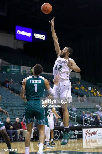Cleveland State Vikings forward Algevon Eichelberger shoots over Green Bay Phoenix guard Sandy Cohen III during the second half of the college...