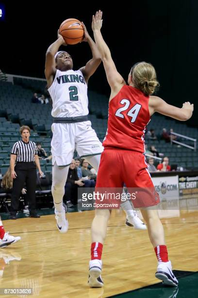 Cleveland State Vikings forward Ashanti Abshaw shoots as Ball State Cardinals guard Jasmin Samz defends during the fourth quarter of the women's...