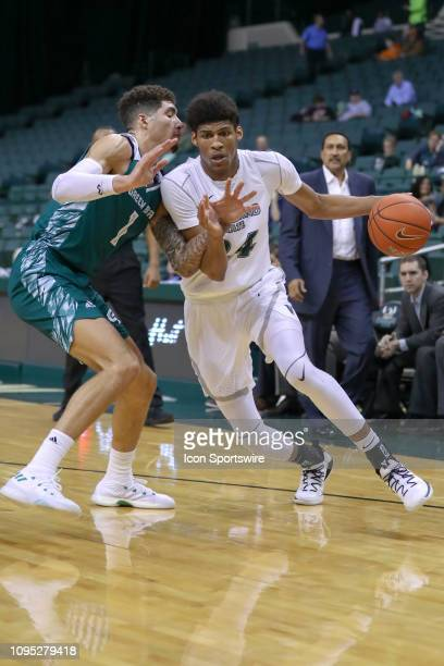 Cleveland State Vikings forward Dibaji Walker drives to the basket against Green Bay Phoenix guard Sandy Cohen III during the second half of the...