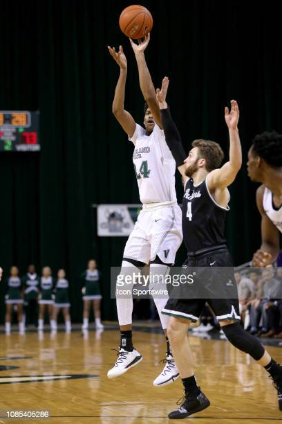 Cleveland State Vikings forward Dibaji Walker shoots over Wright State Raiders guard Alan Vest during the second half of the college basketball game...
