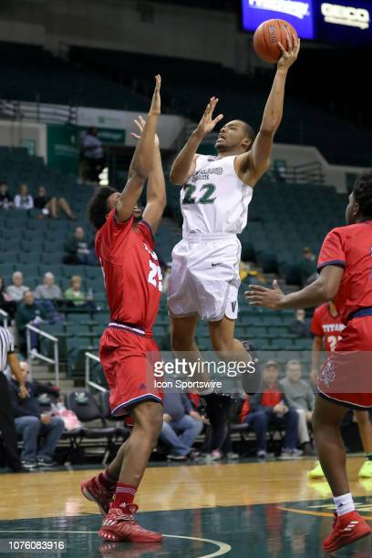 Cleveland State Vikings forward Jaalam Hill shoots over Detroit Titans forward Gerald Blackshear Jr during the second half of the college basketball...