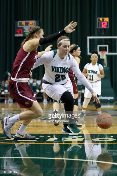 Cleveland State Vikings forward Olivia Voskuhl drives to the basket as IUPUI Jaguars forward Jenna Gunn defends during the fourth quarter of the...
