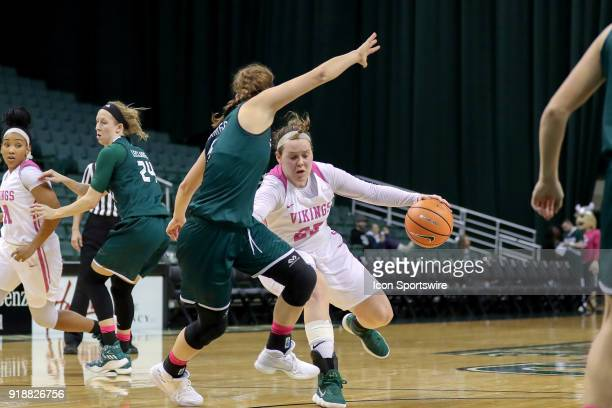 Cleveland State Vikings forward Olivia Voskuhl is defended by Green Bay Phoenix guard Laken James during the fourth quarter of the women's college...