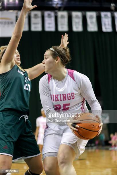 Cleveland State Vikings forward Olivia Voskuhl is defended by Green Bay Phoenix forward Jessica Lindstrom during the third quarter of the women's...