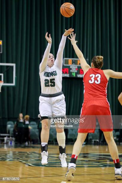 Cleveland State Vikings forward Olivia Voskuhl shoots over Ball State Cardinals forward Moriah Monaco during the fourth quarter of the women's...