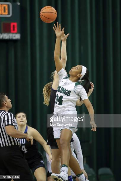 Cleveland State Vikings forward Shadae Bosley wins the opening tip of the women's college basketball game between the Eastern Illinois Panthers and...