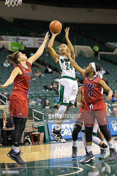 Cleveland State Vikings G Alexis Eckles shoots as UIC Flames F/C Teodora Zagorac and UIC Flames G Terri Bender defend during the first quarter of the...