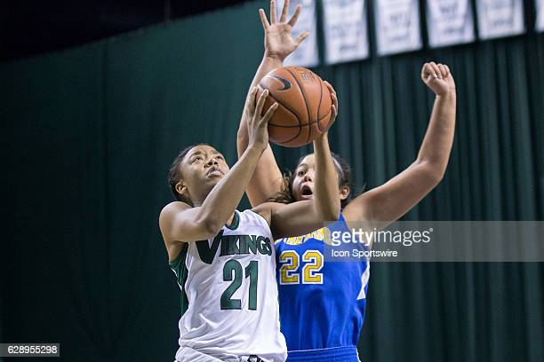 Cleveland State Vikings G Jade Ely drives to the basket as Notre Dame Falcons F Kim Cook defends during the third quarter of the NCAA Women's...
