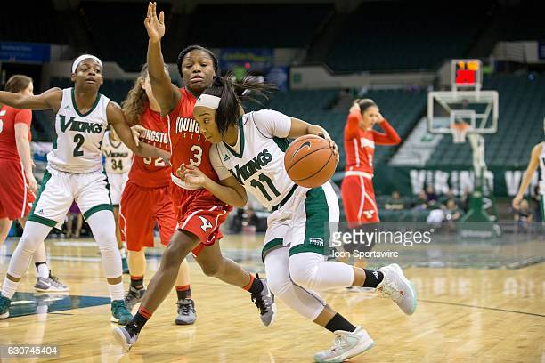 Cleveland State Vikings G Khayla Livingston drive to the basket against Youngstown State Penguins G Indiya Benjamin during the first quarter of the...