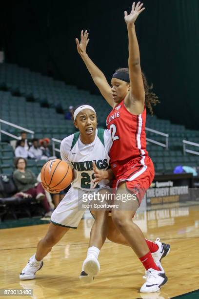 Cleveland State Vikings guard Jade Ely drives to the basket as Ball State Cardinals forward Oshlynn Brown defends during the third quarter of the...