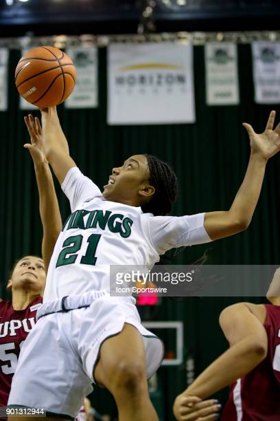 Cleveland State Vikings guard Jade Ely is fouled as she battles IUPUI Jaguars forward/center Macee Williams for a rebound during the third quarter of...