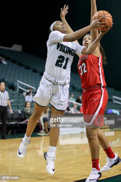 Cleveland State Vikings guard Jade Ely shoots as Ball State Cardinals forward Oshlynn Brown defends during the third quarter of the women's college...