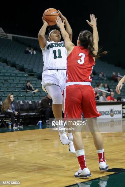 Cleveland State Vikings guard Khayla Livingston shoots as Ball State Cardinals guard Carmen Grande defends during the fourth quarter of the women's...