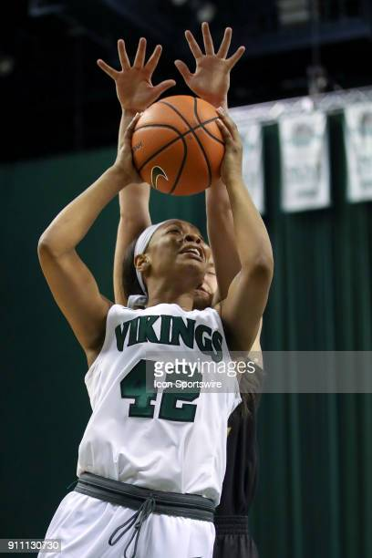 Cleveland State Vikings guard Mariah Miller goes up for a shot as Northern Kentucky Norse guard Molly Glick defends during he fourth quarter of the...