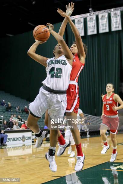 Cleveland State Vikings guard Mariah Miller is fouled by Ball State Cardinals forward Destiny Washington as she goes up for a shot during the fourth...