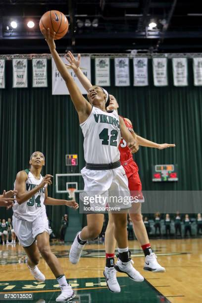 Cleveland State Vikings guard Mariah Miller shoots during the third quarter of the women's college basketball game between the Ball State Cardinals...