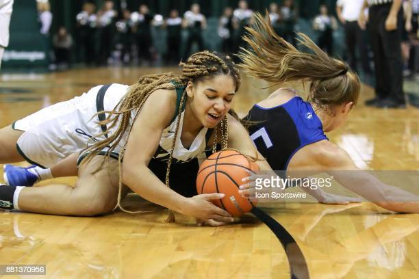 Cleveland State Vikings guard Mariah White beats Eastern Illinois Panthers guard Grace Lennox to a loose ball during the first quarter of the women's...