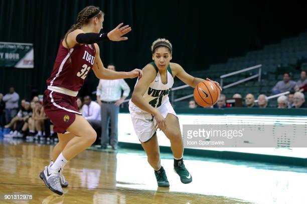 Cleveland State Vikings guard Mariah White is defended by IUPUI Jaguars forward Jenna Gunn during the fourth quarter of the women's college...