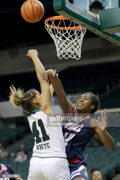 Cleveland State Vikings guard Mariah White is fouled by UIC Flames forward Jada Nneji as she puts up a shot during the fourth quarter of the women's...