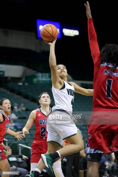Cleveland State Vikings guard Mariah White shoots over Detroit Titans forward Ashley Miller during the fourth quarter of the women's college...