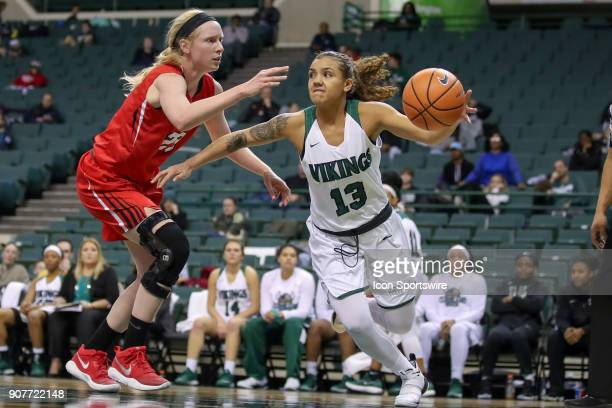 Cleveland State Vikings guard Mariana Bautista looks to pass as Youngstown State Penguins forward Sarah Cash defends during the fourth quarter of the...