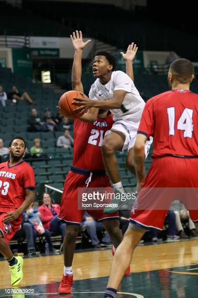 Cleveland State Vikings guard Tyree Appleby shoots as Detroit Titans guard Lamar Hamrick defends during the second half of the college basketball...