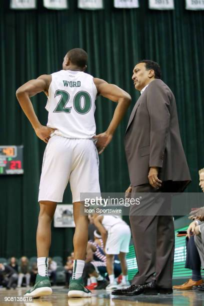 Cleveland State Vikings head coach Dennis Felton talks to Cleveland State Vikings Bobby Word after a technical foul was called on Word during the...