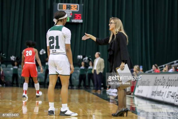 Cleveland State Vikings head coach Kate Peterson Abiad explains a play to Cleveland State Vikings guard Jade Ely during the third quarter of the...