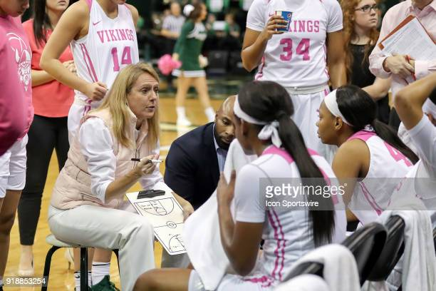 Cleveland State Vikings head coach Kate Peterson Abiad huddles with the Vikings during a timeout during the third quarter of the women's college...