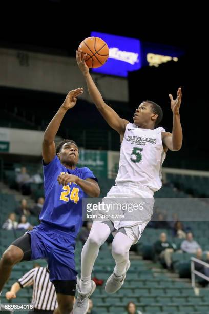 Cleveland State Vikings Tyree Appleby shoots as Notre Dame College Falcons guard Halil Parks defends during the second half of the men's college...