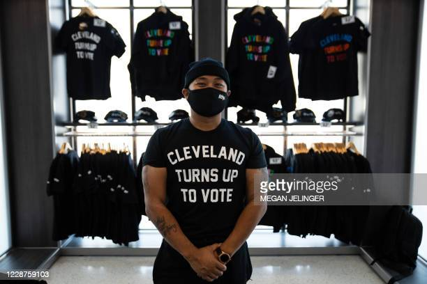 Cleveland Turns Up To Vote shirts designed by local artist ,Glen Infante, hang at Rocket Mortgage Fieldhouse where a voter registration event took...