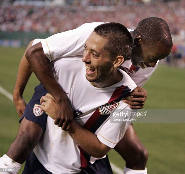Clint Dempsey of the United States National Men's Soccer Team celebrates with teammate DaMarcus Beasley after scoring a goal against Venezuela during...