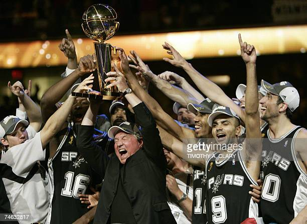 MVP Tony Parker of the San Antonio Spurs celebrates with Spurs' CEO Peter Holt and teammates after leading the San Antonio Spurs to their fourth NBA...