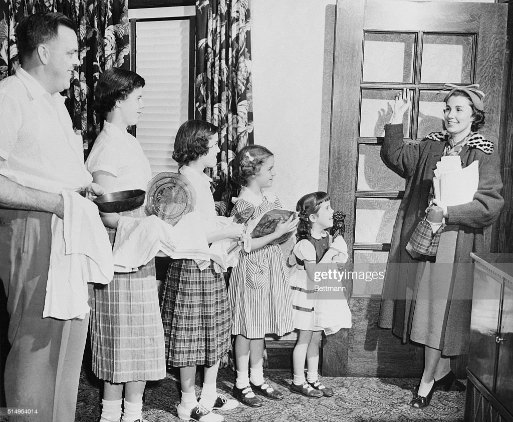 When Mrs. E.J. Siegwarth, Jr. leaves for her teaching job in the morning, she leaves a whole assembly line at home, capable of putting the house to rights in a matter of minutes. In the line up are (left to right): Siegwarth; Peggy, 14; Rosemary, 11 1/2; Janet, 8; and Susan, 5 1/2. This family cooperation enables Mrs. Siegwarth to teach, attend college, and still preside over a spic and span home. November 15, 1953.