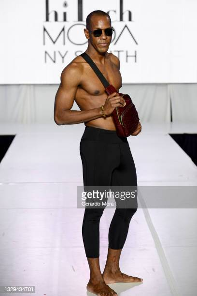 Cleveland Wilson walks the runway for Moody and Co Leather during Orlando Swim Week Powered By hiTechMODA on July 18, 2021 in Orlando, Florida.