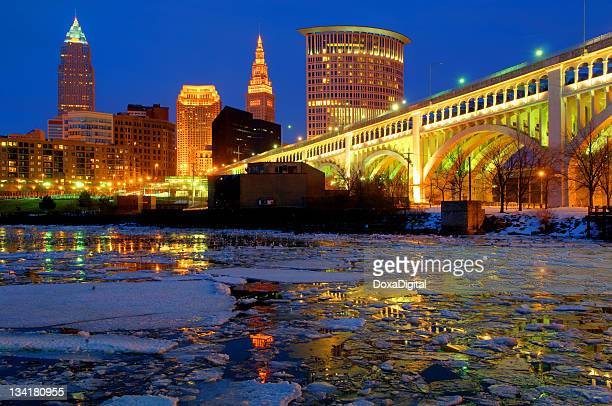 cleveland's downtown skyline on a winter night - cleveland ohio stock pictures, royalty-free photos & images